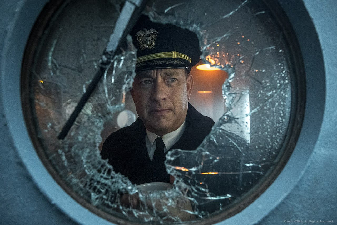 Tom Hanks looks out a damaged porthole on a battleship