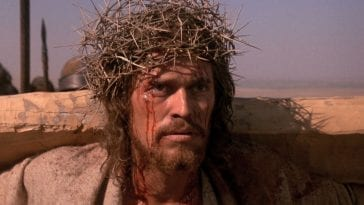 Iconic image of Jesus carrying his cross, wearing his crown of thorns