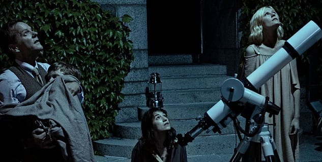 Justine, Claire and John look up at the night sky with a telescope