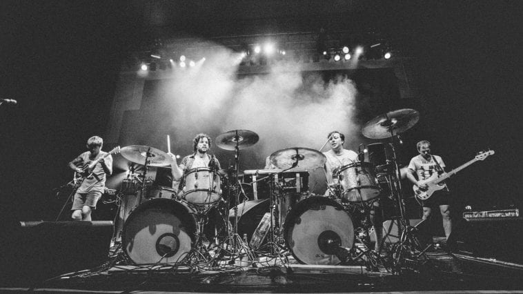 Oh Sees perform on stage in a black and white photo