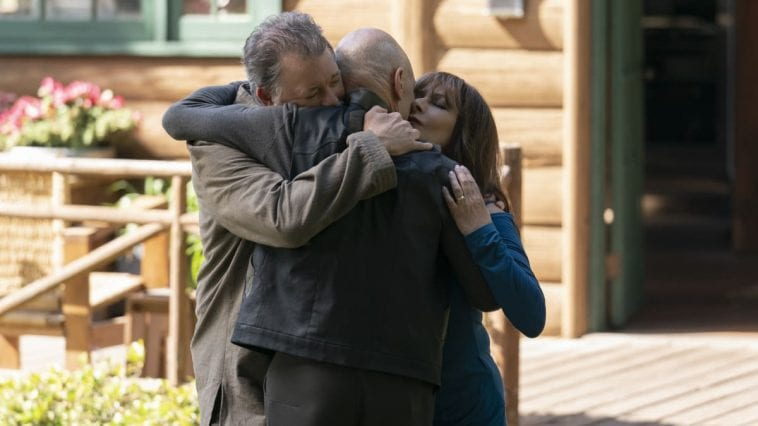 Picard hugs Riker and Troi