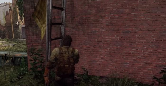 Joel from The Last of Us moves a ladder up against a brick wall.