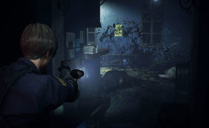 Leon from Resident Evil 2 aims a pistol and flashlight down a gore covered hallway.