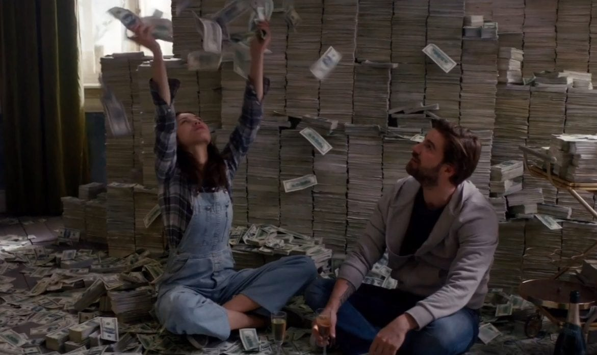 Kate throws up a large stash of money while Matt looks on