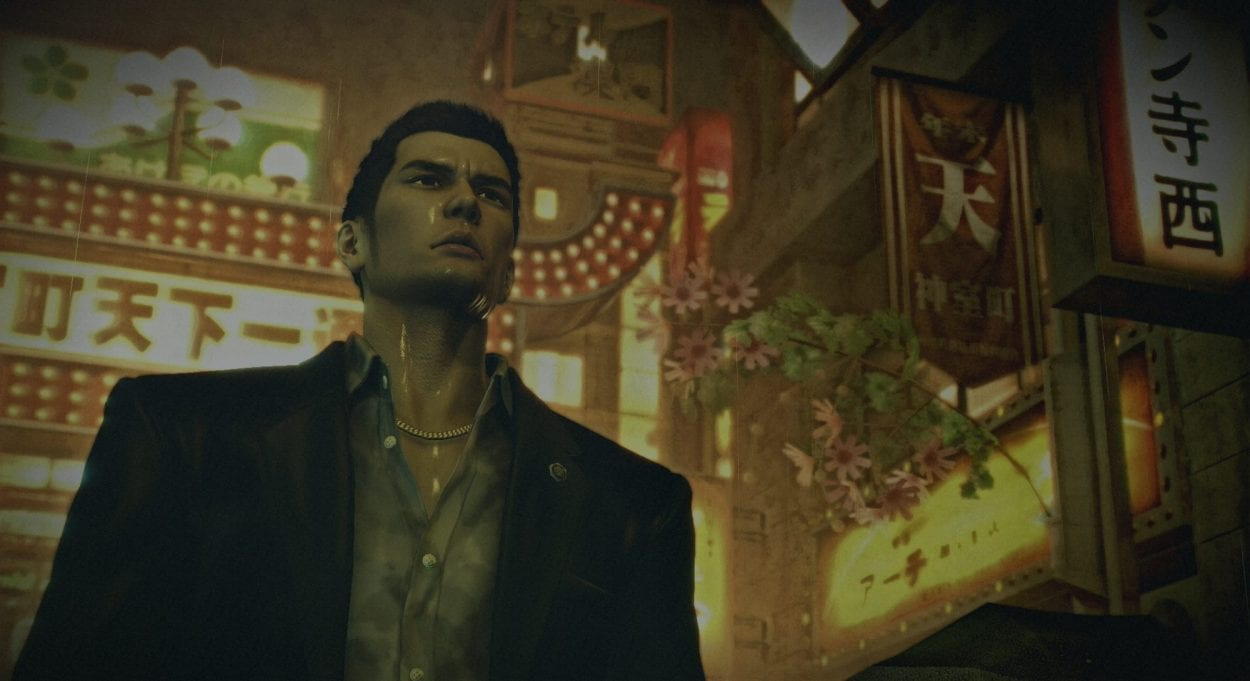 Kazuma Kiryu, one of Yakuza 0's protagonists, stands in a rainy Kamurocho