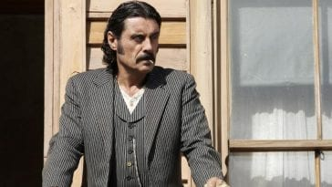Swearengen looks out onto his town of Deadwood