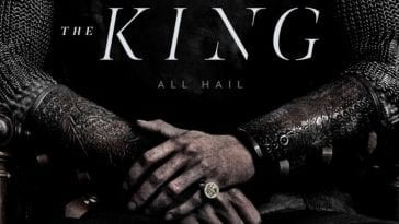"A man's arms with hands folded, wearing chain mail armor and gold ring, with text that reads ""The King, All Hail."""