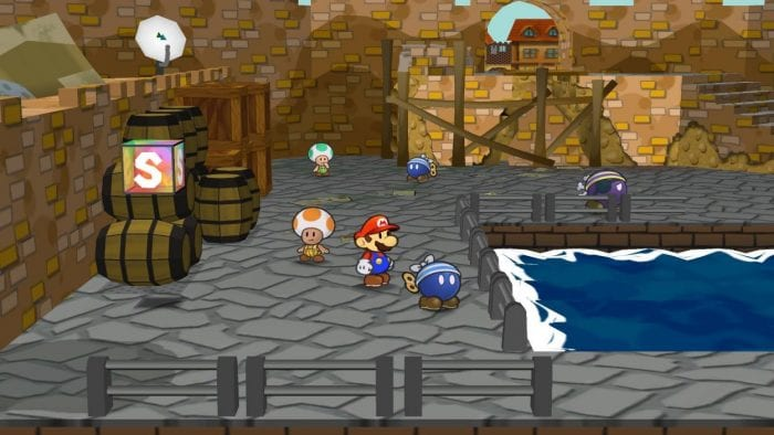 Mario stands in Rogueport's port, where shady Bob-ombs and dirty Toads linger.