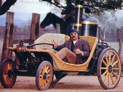 Horseless buggy driven by the dime store novelist Ernest Pratt