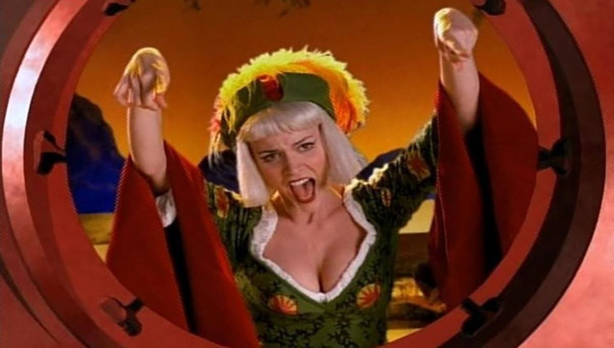 Callisto, as Aleph, the Fool, singing to Xena from beyond a great spinning wheel