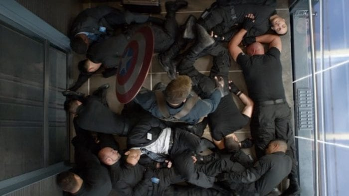 Captain America stands amongst his attackers in an elevator
