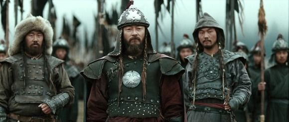 Genghis Khan stands at the front of his army with his General's by his side.