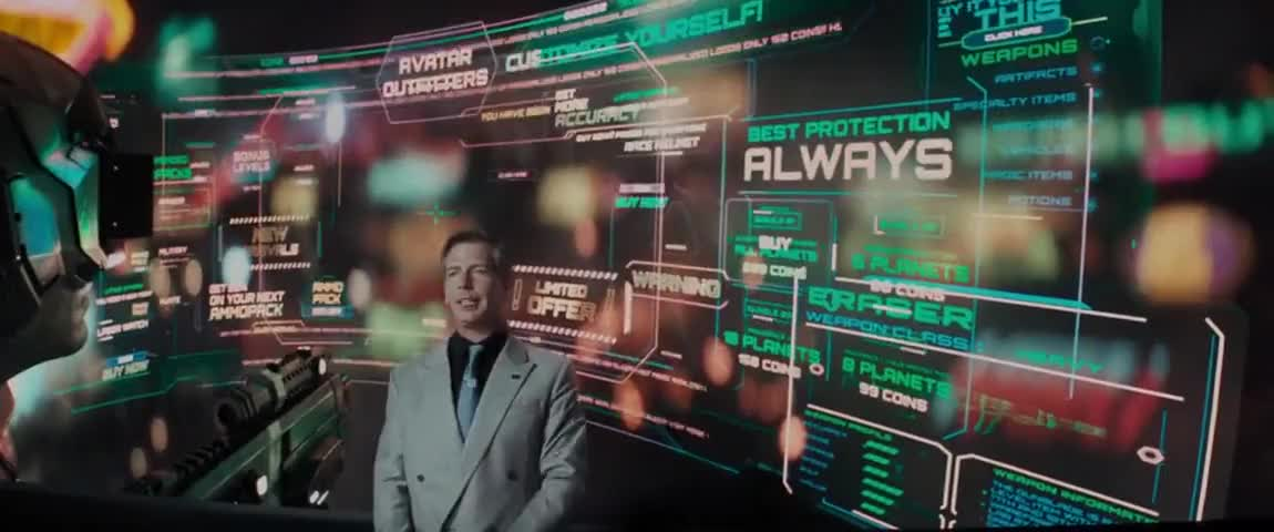 Nolan Sorrento stands in front of a large digital screen that is covered in advertisements