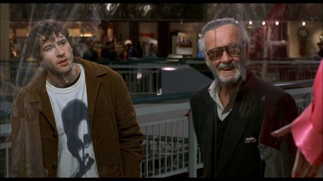 Brodie has a conversation with Stan Lee outside a mall lingerie store.