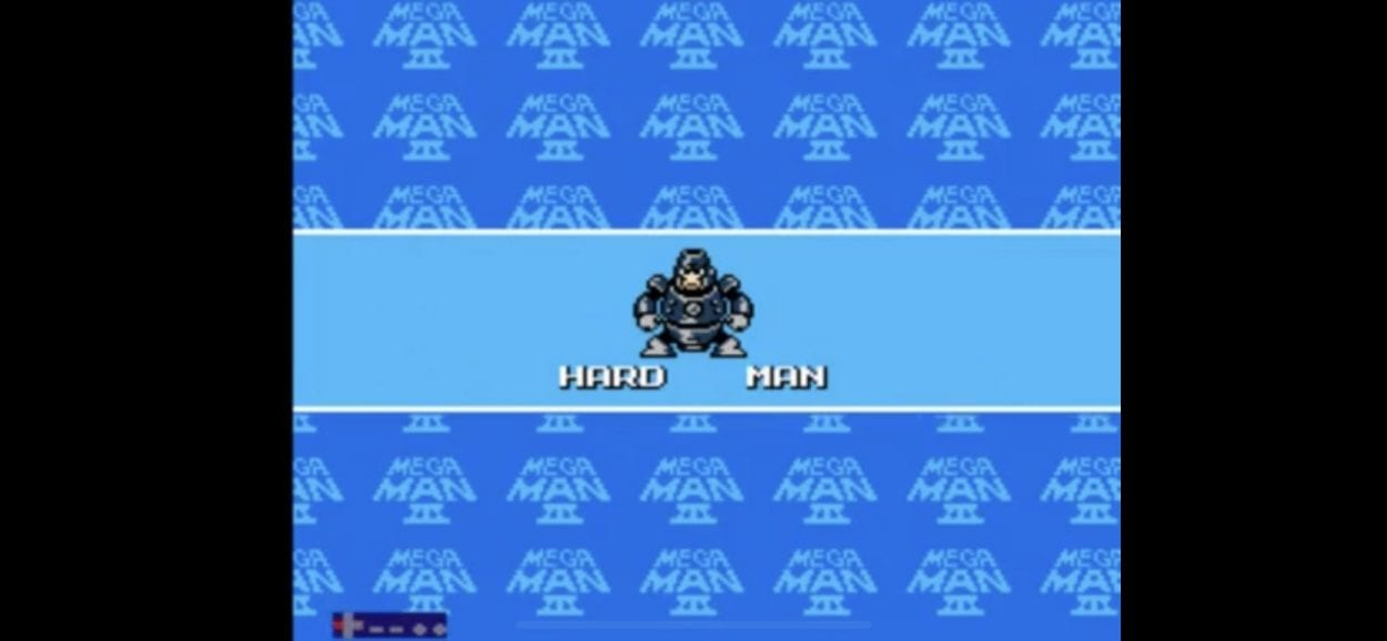 A giant blue humanoid robot stands on a blue stage select bar.