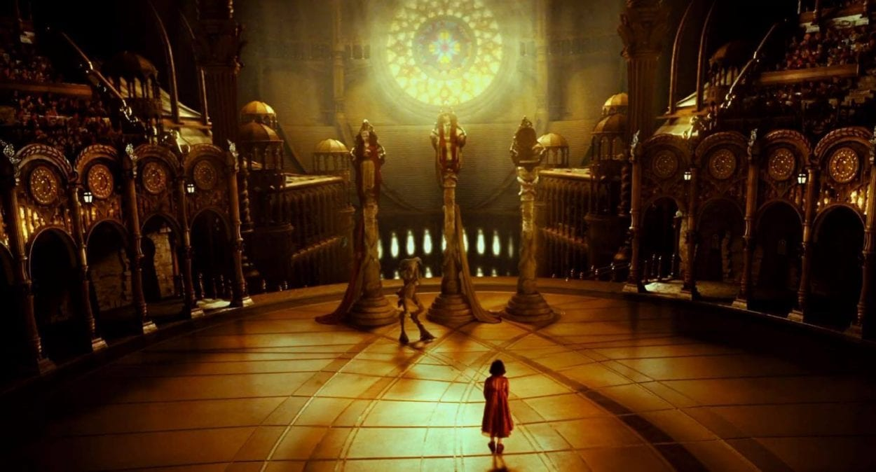 Ofelia stands in a massive golden throne room