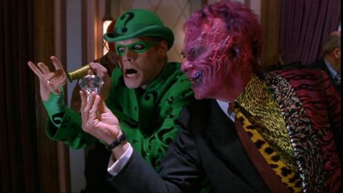 Jim Carrey as The Riddler and Tommy Lee-Jones as Two Face steal a diamond in Batman Forever