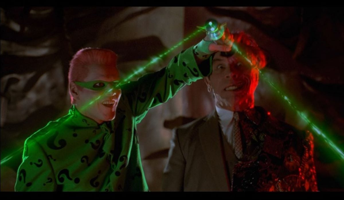 The Riddler and Two Face mess around with The Riddler's mind control device in Batman Forever