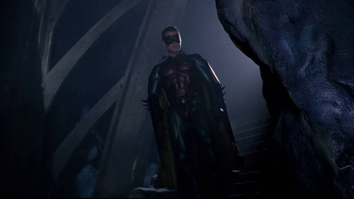 Chris O'Donnell as Robin walks down into the Batcave in Batman Forever