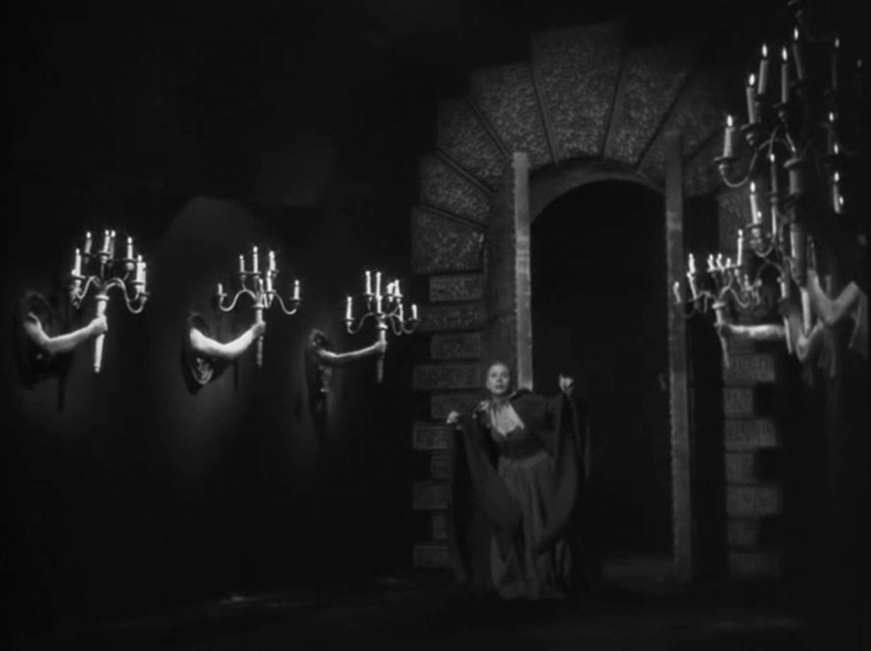 Belle in the castle with candelabras held by human hands