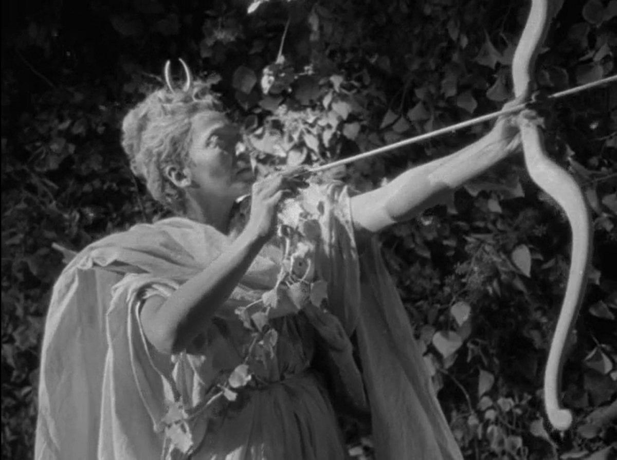 Diana shooting an arrow at a target offscreen