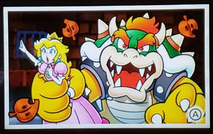 Bowser has Peach is his clutches.