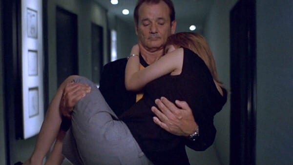 Bob carries Charlotte in his arms