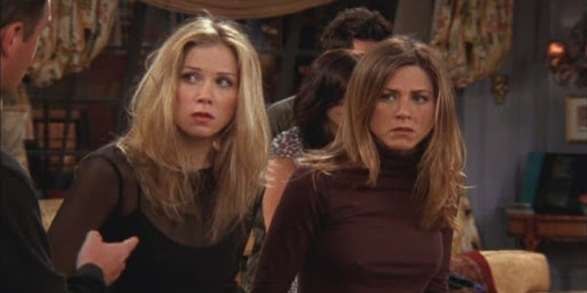 Christina Applegate and Jennifer Aniston on Friends looking to their left and looking nervous
