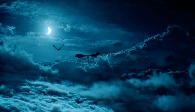 Two dragons do battle in the moonlit sky