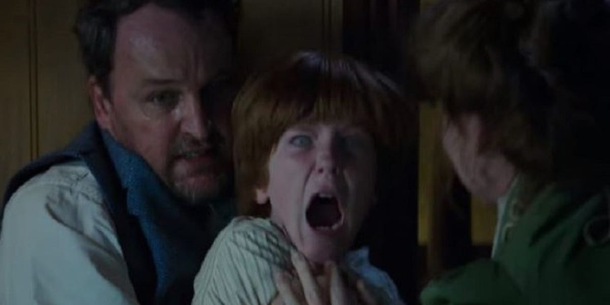 Henry screaming with strange looking eyes while being possessed, held back by Eric with his mother Marion standing before him trying to comfort him in Winchester