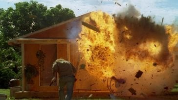 Sawyer runs towards an exploding house in the Barracks