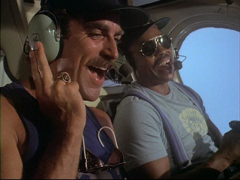 Magnum and TC are riding in TC's helicopter and laughing