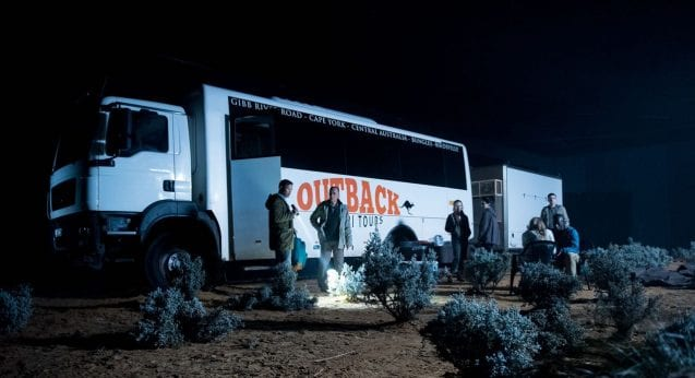 A group of tourists on an outback safari camp out.
