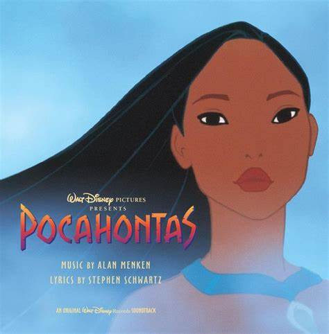 a close up of Pocahontas, black hair sweeping on the breeze. She stands in front of a waterfall and the mist slightly obscures the album title.