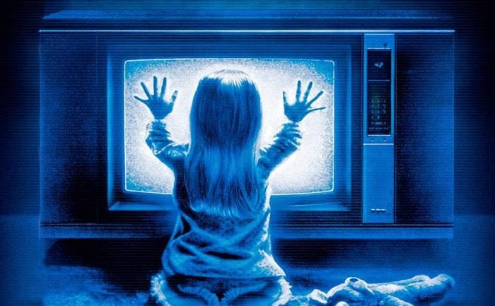 Heather O'Rourke sitting in front of static tv in Poltergeist