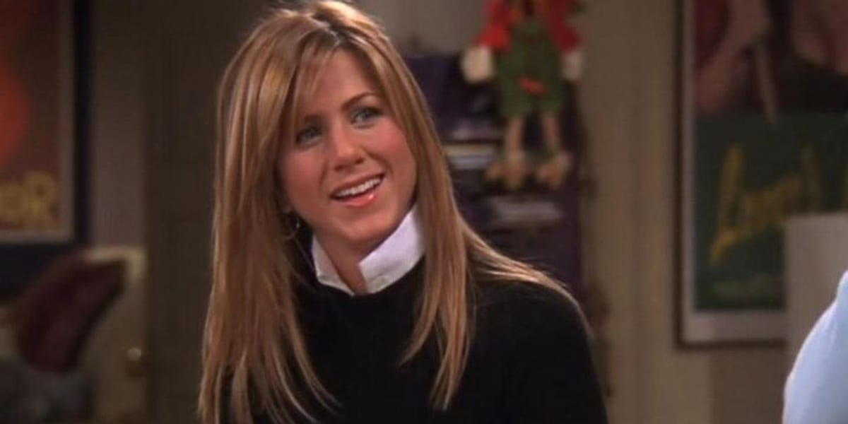 Rachel smiling and looking to her left on Friends