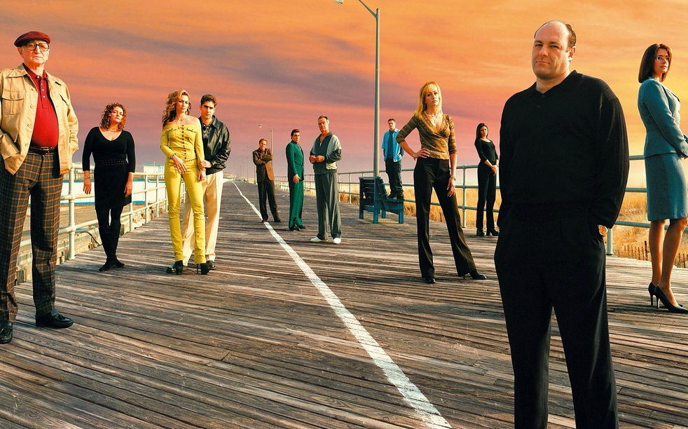 The cast of the Sopranos standing on a boardwalk