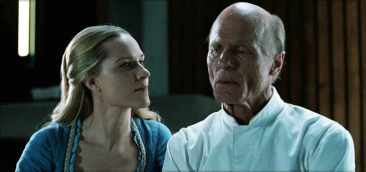 Dolores looks into the eyes of an incarcerated William