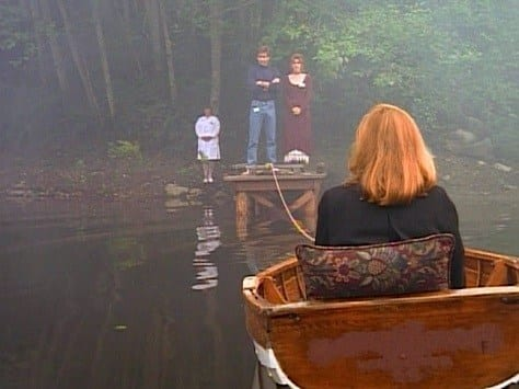 Mulder—arms crossed, and Melissa Wait on the dock in the distance, while we see the back of Scully in the back of a tiny lifeboat tethered to the dock.