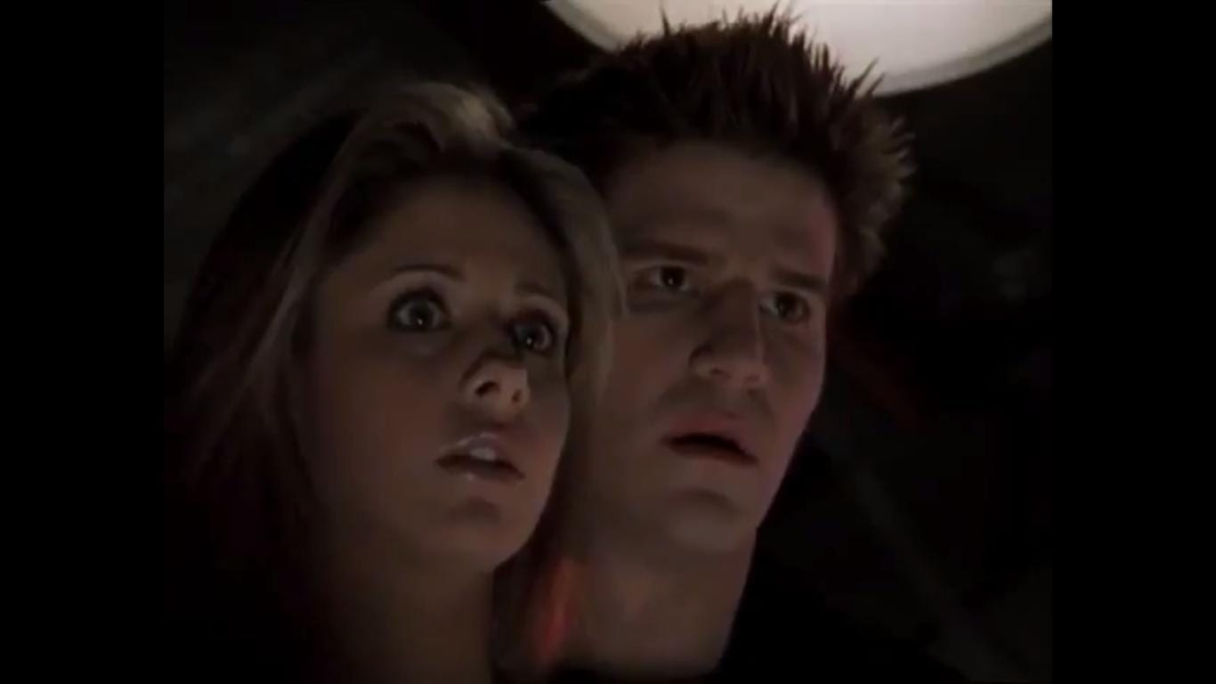 Buffy and Angel look surprised