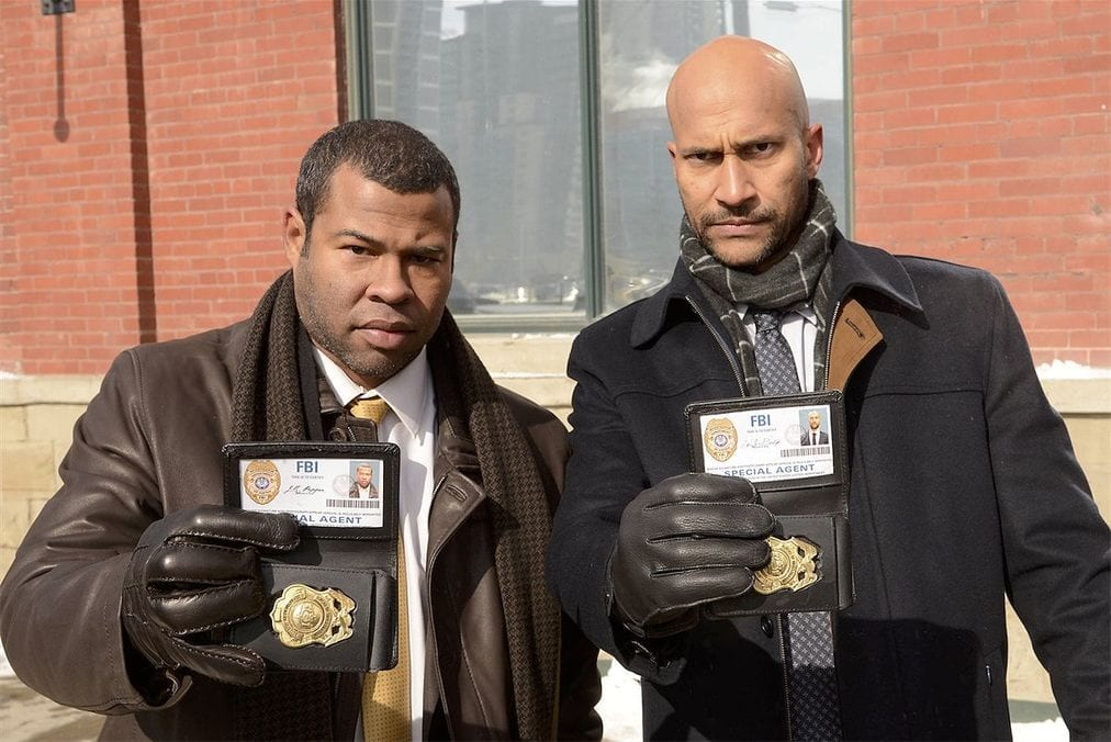 FBI Agents Pepper and Budge showing their badges in Fargo Season 1