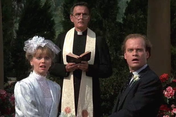 Frasier and Diane Chambers stand at the altar with a priest in the background before Diane leaves Frasier