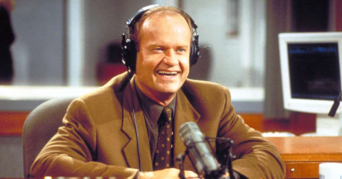 Dr. Frasier Crane smiles in front of a microphone in the radio station