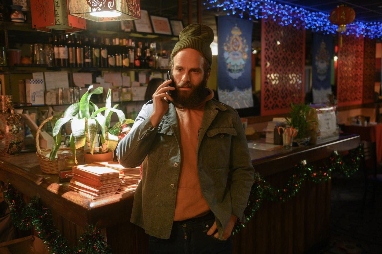 "The Guy is on the phone at a restaurant in High Maintenance ""Soup"""