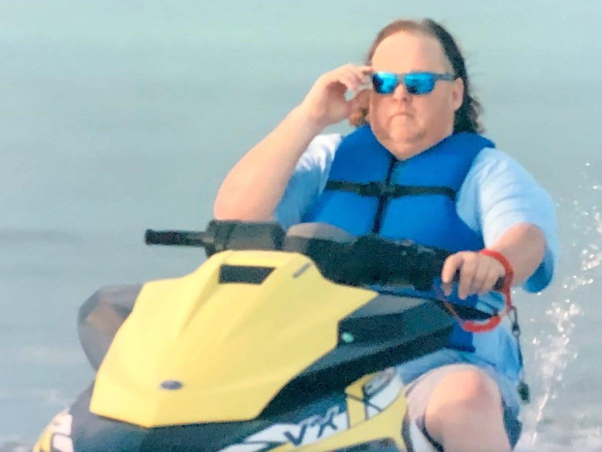 A guy rides a jet ski