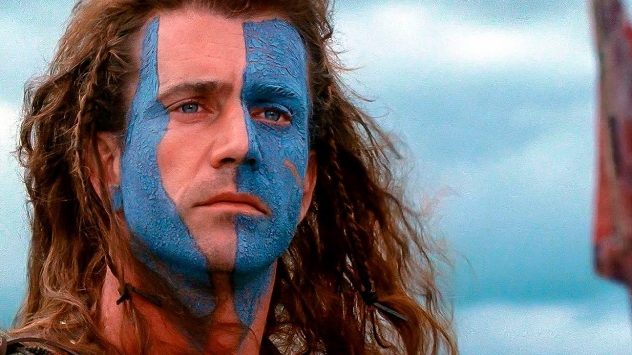 William Wallace with his face painted and hair blowing in the wind