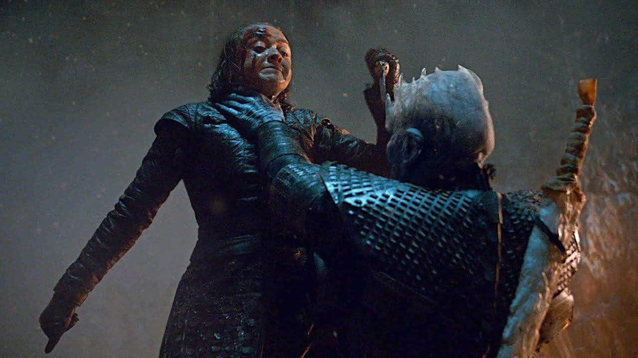Arya is being held by the throat by the Night King with a dagger in her right hand