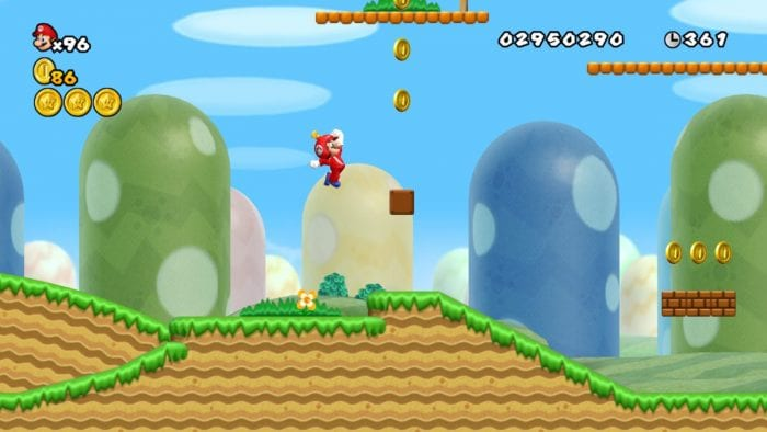 Mario jumps through 1-1 wearing a red Propeller Suit.