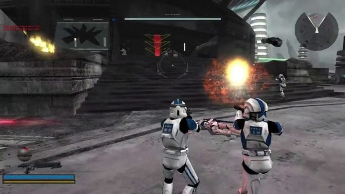 A clone trooper in the original Star Wars Battlefront 2 shoots at a droid