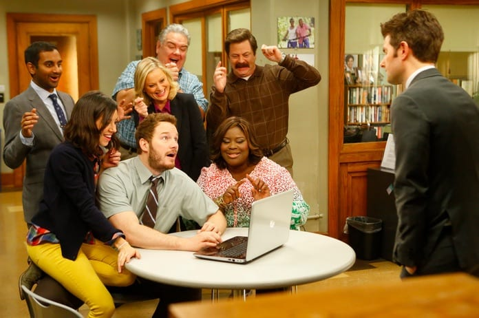 The characters gather around a laptop looking delighted while Ben looks on